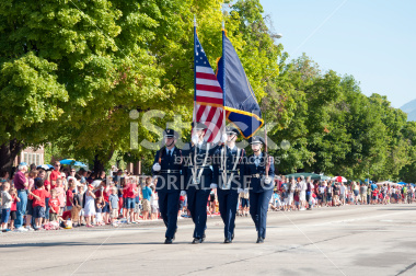 Color Guard Presenting Flags in a Parade