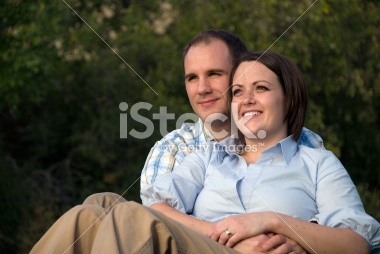 Young Couple Portrait In the Park