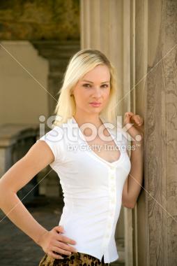 Model Posing By Columns Stock Photograph