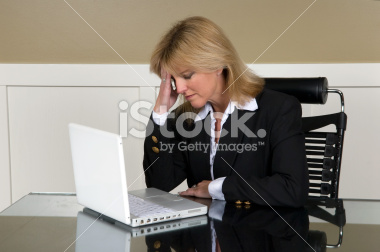 Business Woman Contemplating Bad News